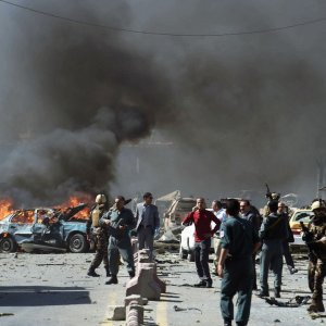 Afghan security forces arrive at the site of a car bomb attack in Kabul on May 31.