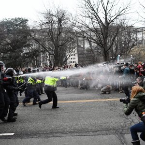 Police pepper spray at anti-Trump protesters during clashes in Washington, DC, on January 20.(Photo: AFP)