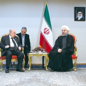 Chairman of the Palestinian National Council Salim Zanoun (L) meets President Hassan Rouhani in Tehran on Feb. 22.