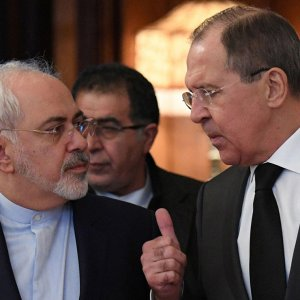 Foreign Minister Mohammad Javad Zarif (L) and his Russian counterpart, Sergey Lavrov, held talks on Syria in Moscow on Dec. 20.