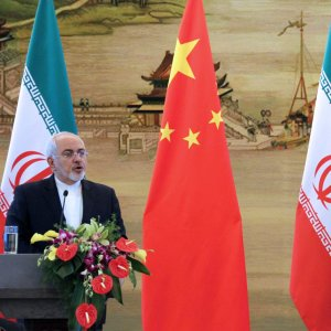 Foreign Minister Mohammad Javad Zarif (L) and his Chinese counterpart, Wang Yi, attend a joint press conference in Beijing on Dec. 5.