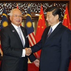 Najib Razak (L) and Xi Jinping in Beijing in November.