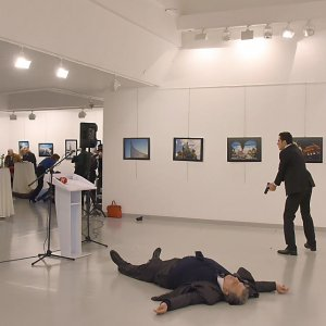 The gunman Mevlut Mert Altintas is seen at the scene of the assassination next to the body of the Russian ambassador, Andrey Karlov.