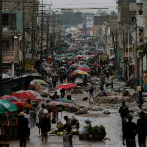 Vendors sell their goods on the street while Hurricane Matthew approaches in Port-au-Prince, Haiti, on Oct. 3.