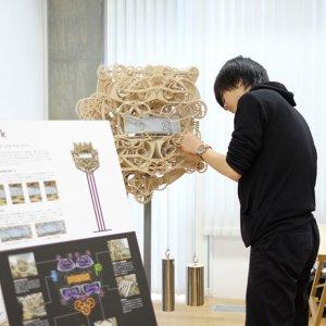 Japanese Student Builds  Unique Wooden Clock