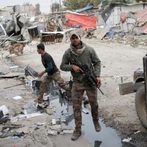 Iraqi special forces soldiers walk in Mosul, Iraq, on Nov. 15.