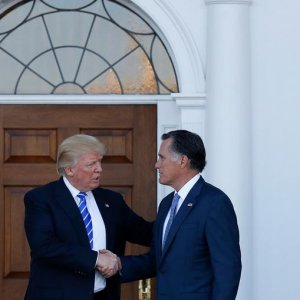 The 2012 Republican presidential nominee, Mitt Romney, met with president-elect Donald Trump on Saturday, trading smiles and tight handshakes as the two set aside a fierce rivalry.