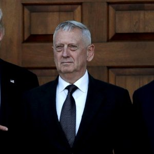 President-elect Donald Trump (L) and vice president-elect Mike Pence (R) greet retired Marine General James Mattis for a meeting  at the main clubhouse at Trump National Golf Club in Bedminster, New Jersey, on Nov. 19.