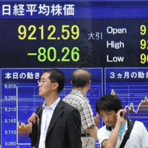 Asian Shares Shaky, EM Under Pressure