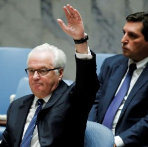 Russia's ambassador to the United Nations, Vitaly Churkin, vetoes a Security Council resolution on Syria at the UN headquarters in New York on Oct. 8.