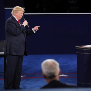 Donald Trump speaks as Hillary Clinton listens during their second debut on October 9.