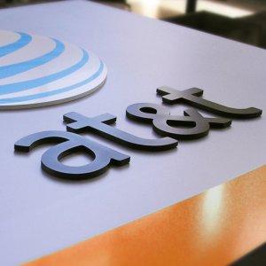 AT&T, Time Warner Shares Dip