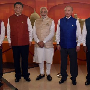 (From Left) President Michel Temer, President Xi Jingping, Prime Minister Narendra Modi, President Vladimir Putin and President Jacob Zuma pose in front  of sand art representing national monuments from BRICS member countries in Goa on October 15.