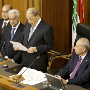 Newly elected Lebanese President Michel Aoun gives a speech next to the Parliament Speaker Nabih Berri (R) as he takes an oath in Beirut on October 31.