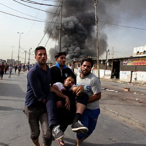 Two Bombings in Baghdad Kill 13