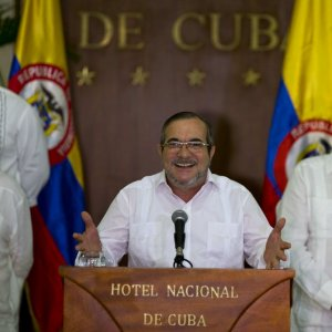 Commander of the Revolutionary Armed Forces of Colombia or FARC, Rodrigo Londono, talks to the press, accompanied by Ivan Marquez (R) chief negotiator of FARC and Pablo Catatumbo (L) chief of the FARC's  western bloc, in Havana, Cuba, Sunday, August 28.