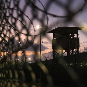 A guard tower stands at the perimeter of Camp Delta in the Guantanamo Bay detention center on March 30, 2010. (File Photo)