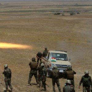 Kurdish Peshmerga forces fire a rocket toward IS militants on the southeast of Mosul, Iraq, on Aug. 14.