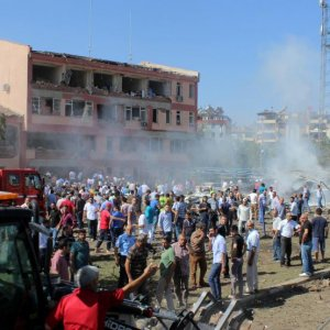 People rush to the blast scene after a car bomb attack on a police station in the eastern city of Elazig, Turkey, on Aug. 18.