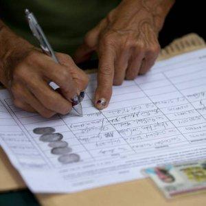 Venezuela to Confirm Recall Voters' IDs