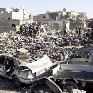 People search for survivors under the rubble of houses destroyed by an airstrike near Sana'a Airport, Yemen. (File Photo)
