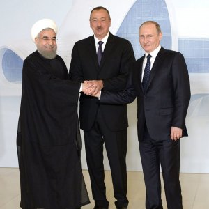 The presidents of Iran (Hassan Rouhani, on the left), Azerbaijan (Ilham Aliyev center) and Russia (Vladimir Putin) at a trilateral meeting in Baku on August 8.