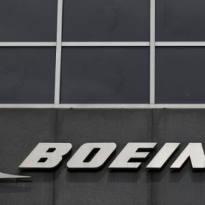 Boeing Profit Hit by Tanker Charge