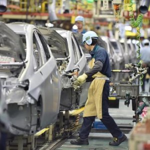 Japan Told to Raise Wages