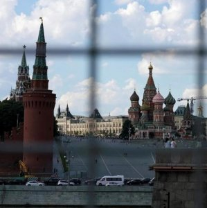 A view through a construction fence shows the Kremlin towers and St. Basil's Cathedral on a hot summer day in central Moscow, Russia, on July 1, 2016.(File Photo)