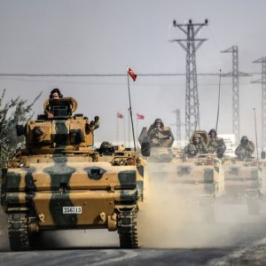 This file photo taken around 5 kilometers west from the Turkish Syrian border city of Karkamis in the southern region of Gaziantep, on August 25, 2016, shows Turkish Army tanks driving to the Syrian Turkish border town of Jarablus.
