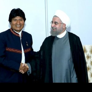 Bolivian President Evo Morales (L) shakes hands with his Iranian counterpart, Hassan Rouhani, in Venezuela on Sept. 17.