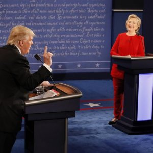 Republican US presidential nominee, Donald Trump, speaks as Democratic US presidential nominee, Hillary Clinton, listens during their first presidential debate at Hofstra University in Hempstead, New York, USA, on Sept. 26.
