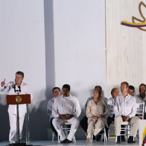 Colombia's President Juan Manuel Santos (L) delivers a speech after he signed a peace agreement between Colombia's government and the FARC in Cartagena, Colombia, on Sept. 26.