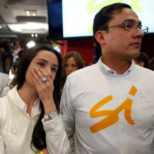 """A supporter of """"Si"""" vote cries after the nation voted """"NO"""" in a referendum on a peace deal between the government and FARC rebels, at Bolivar Square in Bogota, Colombia, on Oct. 2."""