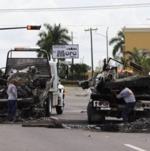 Burned-out vehicles were left on the road after the ambush on a military convoy in Sinaloa.
