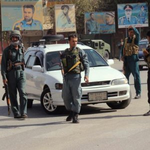 Afghan policemen keep watch in the downtown of Kunduz city, Afghanistan, on Oct. 3.