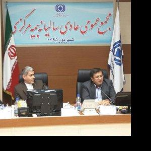 Abdolnasser Hemmati (R) CII head, and Ali Tayyebnia minister of economy at the annual insurance assembly.