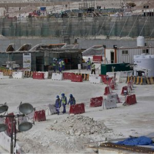 Migrant workers at the site of the pitch of the Al-Wakra Stadium that is under construction for the 2022 World Cup.
