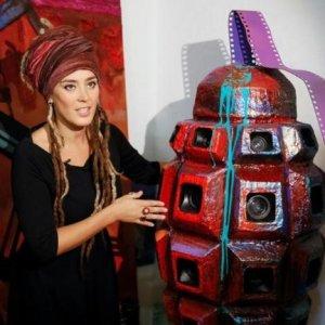 Daria Marchenko speaks to journalists near the artwork 'Brain of War'. (Photo: Reuters)