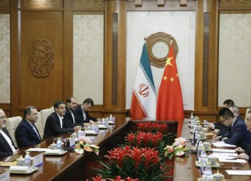 Chinese State Councillor and Foreign Minister Wang Yi (R) holds talks with Iranian Foreign Minister Mohammad Javad Zarif (L) at the Diaoyutai state guesthouse in Beijing on May 13.