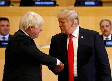 US President Donald Trump shakes hands with British Foreign Secretary Boris Johnson (L) in New York on September 18, 2017.