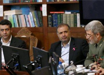 Defense Minister General Amir Hatami (R) addresses a parliamentary meeting in Tehran on April 15.