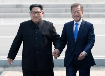 North Korean leader Kim Jong-un (L)and South Korean President Moon Jae-in meet in the truce village of Panmunjom inside the demilitarized zone separating the two Koreas on April 27.