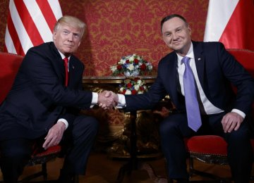 US President Donald Trump (L) and Polish President Andrzej Duda shake hands during their meeting in Warsaw on July 6, 2017.
