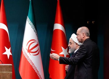 Iran's President Hassan Rouhani (left) met with his Turkish counterpart Recep Tayyip Erdogan in Ankara on December 20, 2018.