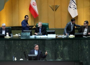 CBI Governor Valiollah Seif (Foreground) addresses the Iranian Parliament on April 10.