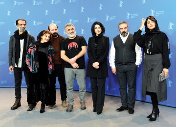 From left to right: Ali Bagheri, Leili Rashidi, Ali Mosaffa, Mani Haghighi, Leila Hatami, Hassan Majouni  and Parinaz Izadyar pose during the photo call for 'Pig' in Berlin, February 21. (Photo: AFP)