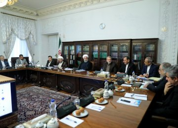 President Hassan Rouhani, flanked by Parliament Speaker Ali Larijani (R) and Judiciary Chief Ayatollah Sadeq Amoli Larijani, attended the meeting in Tehran on June 19.