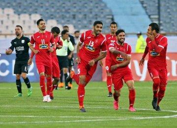 Reds celebrate their goal at Azadi Stadium in Tehran.