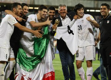 ranian national players and Carlos Queiroz celebrated entering World Cup Russia after beating Uzbekistan  in Asian qualifiers last June.